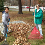 Volunteers with rakes