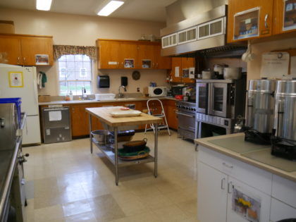 large kitchen with island counter.