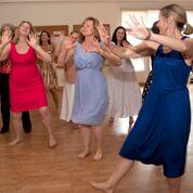 people dancing on wooden floor