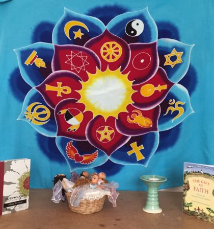 mandala wall hanging, chalice and books.